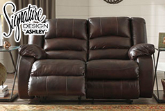 Levelland  Reclining Loveseat  in Genuine Leather <br />  by Ashley - Click for more details